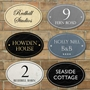 Picture of Oval Classic Stone Effect Shaped House Number Sign