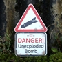 Picture of Danger Unexploded Bomb! Sign
