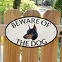 Picture of Doberman Pinscher Beware of The Dog Gate Sign