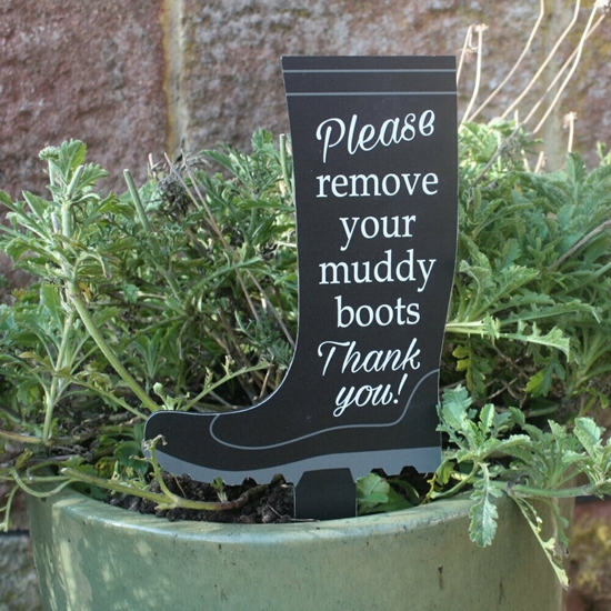 Picture of Remove your shoes sign on spike